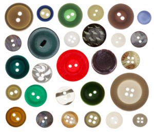 collection of various sewing button on white background